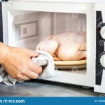 Raw Chicken In The Microwave Stock Image - Image of defrosting, kitchen:  135988047