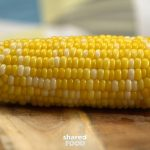 Slide the husk and silk off the corn on the cob   Corn in the microwave,  Cooking sweet corn, How to cook corn