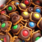 Hey good lookin, whatcha got cookin?: Pretzel, Hershey Kiss, and M&M Bites  | Chocolate treats, Desserts, Pretzel treats