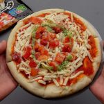 How do I cook a frozen pizza in the microwave?
